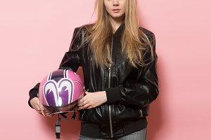 Biker girl with motorcycle helmet