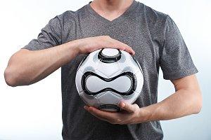 Man hold modern football ball