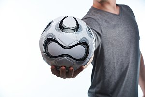 Football ball in player hand