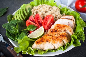 Fresh salad from quinoa, chicken breast, spinach, lettuce and to