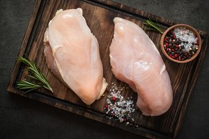 Raw chicken fillet on cutting board