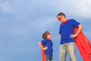 Father and son playing superhero