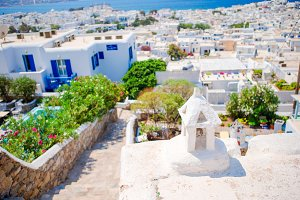 Top view of the old city and the sea in Mykonos, Greece. A lot of white houses an colorful doors