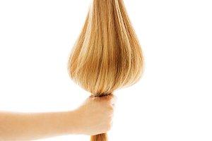 Long blond human hair close-up.