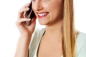 Attractive young woman making a phone call.