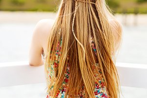 Back view of the young female with beautiful blond straight long hair