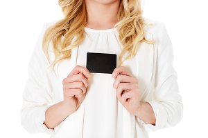 Happy woman showing business card, isolated over white backround.