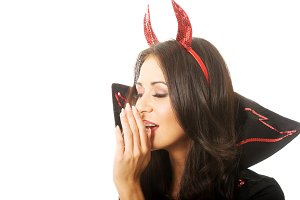 Portrait of woman wearing devil clothes whispering to someone