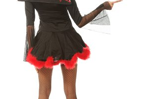 Back view of woman pointing right wearing devil clothes