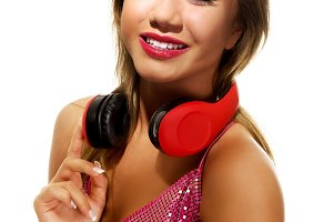 Party woman with headphones listening to music.
