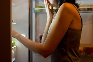 Women and food in the fridge