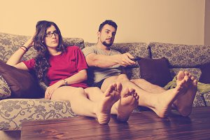 Boring couple watching tv
