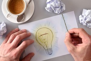 Idea concept with light bulb drawn