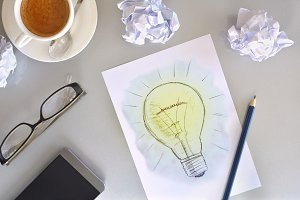 Idea concept with light bulb top