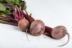 Red fresh beetroot on wooden board