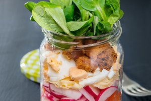 Glass jar with fresh salad