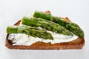 Single sandwich with cream cheese and asparagus
