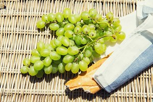 Picnic concept - wine, cheeses and grapes