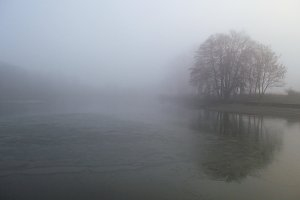 Fog on the lake in early spring.