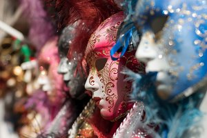 Closeup view of beautiful ornate venetian carnival red mask