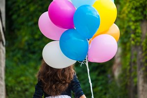 Girl with colorful balloons
