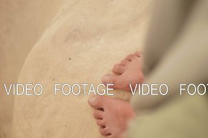 bare foot of young girl in the desert