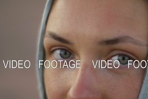 eyes of beautiful young woman with scarf on head