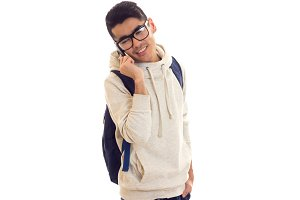 Young man with glasses, smartphone and backpack