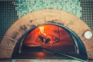 Preparing traditional italian pizza.
