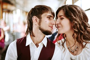 Young hipster couple kissing