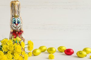 Easter composition with chocolate rabbit and eggs