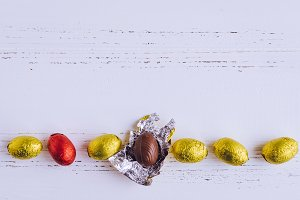 Easter composition with chocolate eggs