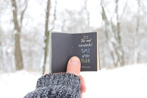 It's the most wonderful time of the year. Book with inscription. Quote about winter season