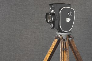 Old movie camera on a tripod