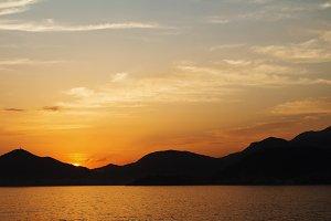 Sunset mountain sea beach