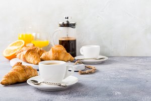 Healthy breakfast with coffee and croissants