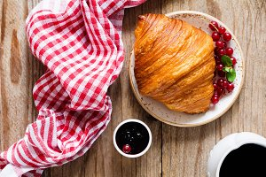 Croissant with jam and coffee
