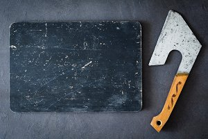 Old wooden board and meat cleaver