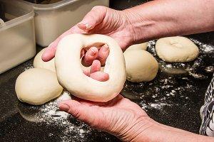 Baker making fresh bagels