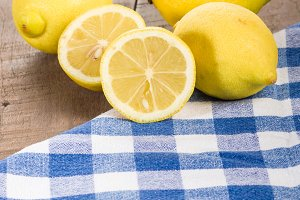 Yellow lemons on wooden table