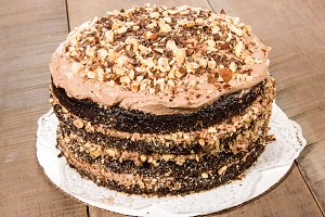 Chocolate cake with frosting and hazelnut topping