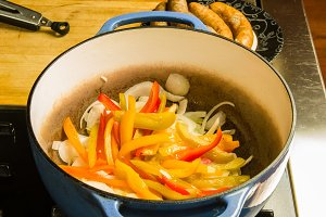 Colorful pepper slices in cooking pot