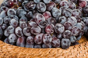 Red grapes in a wicker basket