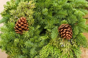 Evergreen wreath with pine cones and cedar