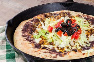 Skillet pizza with olives and tomatoes