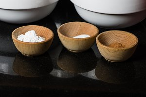 Wooden bowls with spices and ingredients