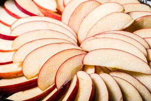 Apple slices arranged in skillet