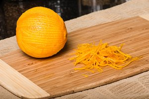Orange being cut to produce zest