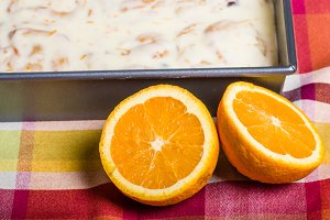 Oranges with fresh sweet rolls
