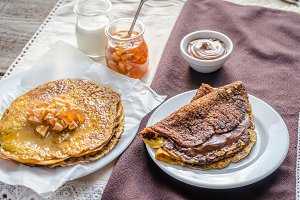 Pumpkin crepes with jam and cream